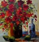 Red flowers in vase with bottle