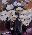 Vase of white flowers with purple