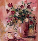 Floral arrangement with cup and saucer